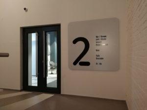 """табло перед входом на этаж в офисе компании """"Петер-Сервис"""""""
